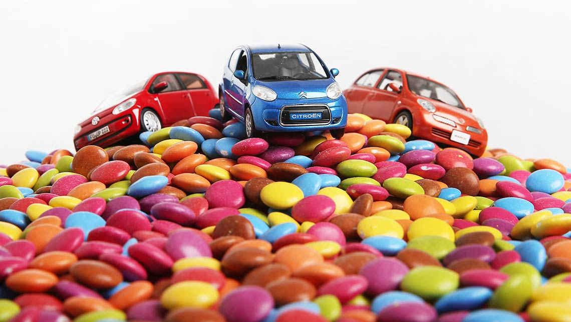 Miniature cars surrounded by smarties