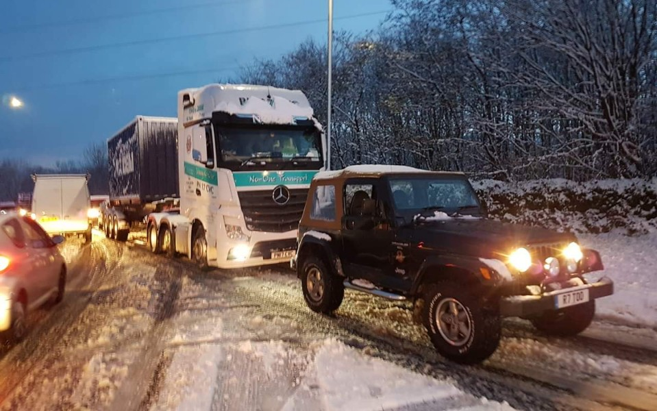 jeep - jeep tows truck 1 - Jeep pulls truck out of snowdrift