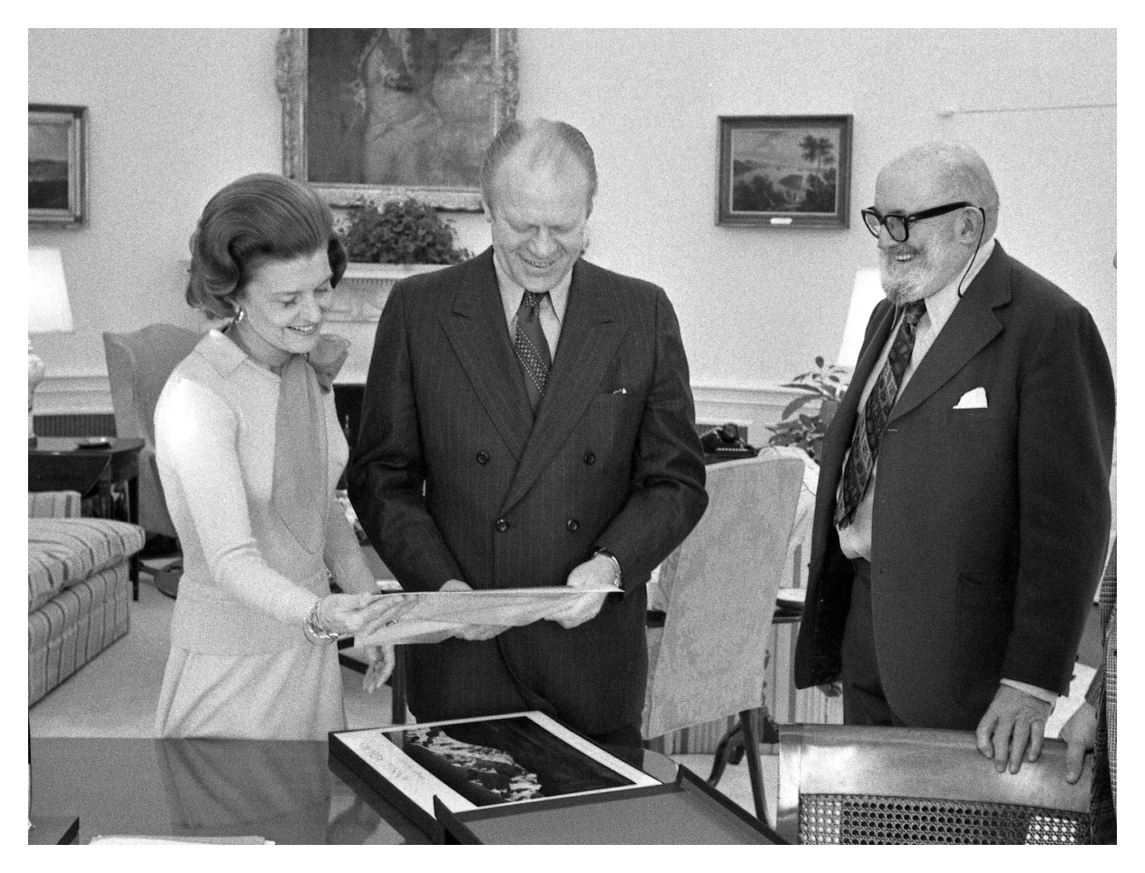 President Gerald Ford and First Lady Betty Ford viewing photographs with Adams 1975