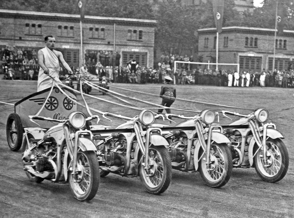 A German Army soldier drives a %E2%80%98team of motorcycles from a chariot in a competition race at the Potsdam Army Show Germany September 5 1938 1